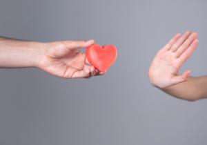 Hand pushing love away